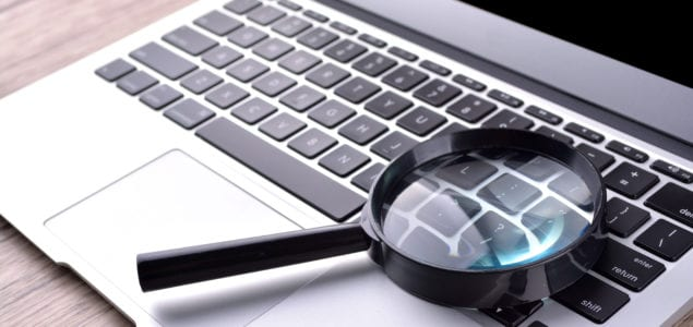 magnifying glass and laptop