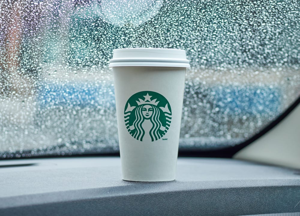 Starbucks cup in a car