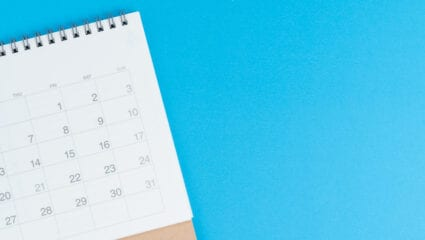 calendar laying on a blue background